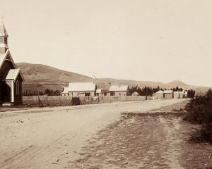Early days in Millers Flat; Portuguese Hill can be seen in the background to the right of the...