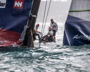 American Magic just after capsizing during the Prada Cup. Photo: Michael Craig/NZ Herald