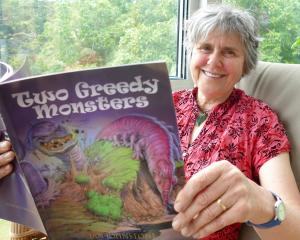 Jan Johnstone, of Puerua, near Balclutha, checks a copy of her newly published climate change...