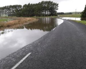 Surface flooding on Henderson Rd at Boggyburn, near Winton in Southland. Photo: Southland...