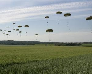 British paratroopers from the 3rd Parachute Battailon, England, land in a wheat field outside the...