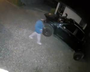 A still of CCTV footage showing an unidentified man attempting to entering a vehicle in Shotover...