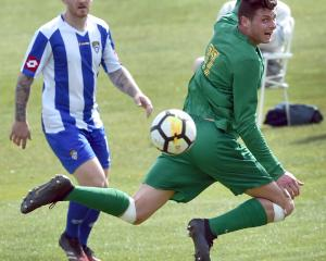 Green Island player Matthew Brazier flicks the ball with his heel during the South Island...