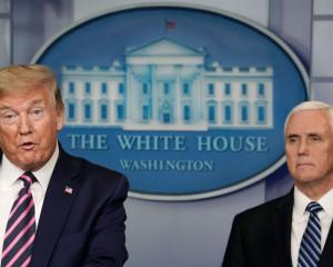 Vice President Mike Pence (right) says he won't use the 25th Amendment to oust President Donald...