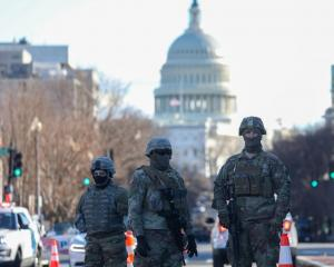 Police and National Guard soldiers near the US Capitol Building in Washington. Photo: Getty Images