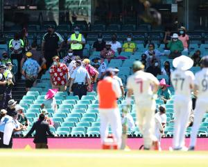 Indian players look to towards a section of crowd where an alleged racial comment was directed at...