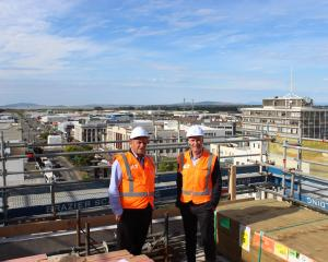 ILT chairman Alan Dennis and chief executive Chris Ramsay stand on the seventh floor of the...