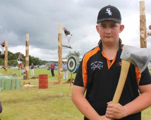Eastern Bush resident Jack Richards takes part in the wood-chopping competition at the Tuatapere...