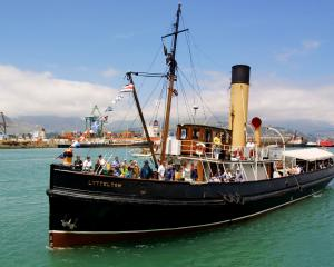 Tug Lyttelton heads into the harbour. Photo: Geoff Sloan