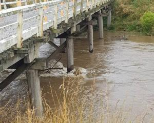 Safety signage was taken from the Channel Rd bridge at Tussock Creek, which was closed due to...