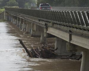 Flood debris is trapped under the Outram Bridge during the weekend's heavy rain. PHOTO: GERARD O...