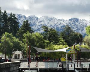 The snow-dusted Remarkables loom behind Queenstown Gardens this morning. Photo: Guy Williams