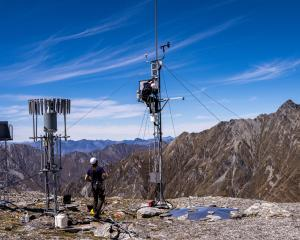 Niwa researcher James Townshend services the snow and ice monitoring station on Mt Larkins, near...