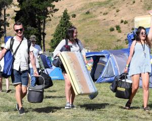 Friends Steele Bartlett, Alex Roach and Katie Mead, from Nelson, arrive at Rhythm and Alps in the...