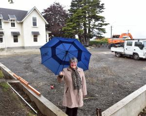Columba College principal Pauline Duthie stands on the construction site of the school's new $150...