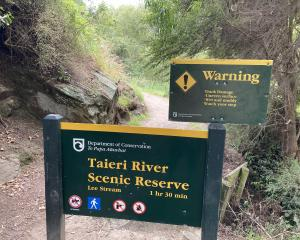 The Department of Conservation sign at the start of the walk, at the Outram Glen car park. PHOTOS...