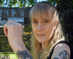 Tracey Mains displays tattoos of George Michael, Freddie Mercury and David Bowie, created by...