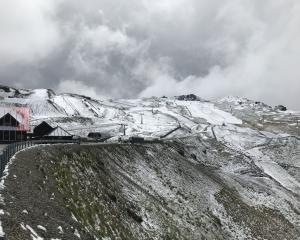 There was a glimmer of sunshine as snow fell thick and fast on the summits at Cardrona Alpine...