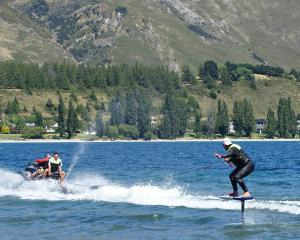 Kelly Gooch demonstrates the newly available activity of foil surfing on Lake Wanaka yesterday....