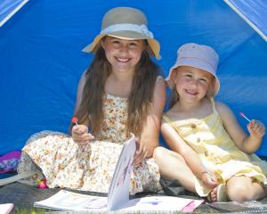Ava (9) and Keira Goodman (5), of Dunedin, made the most of some shade at the Waikouaiti Racing...