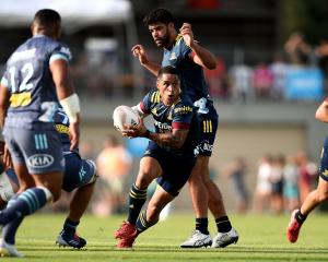 Aaron Smith, of the Highlanders, runs the ball during his side's Super Rugby Aotearoa pre-season...