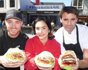 Fergburger team members Alex Drummond, left, and Marine Prudhon, centre, with Fergburger group...