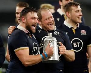Scotland's WP Nel and Rory Sutherland celebrate with the Calcutta Cup after the match. Photo:...