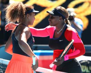 Naomi Osaka (left) is congratulated by Serena Williams after the match. Photo: Reuters