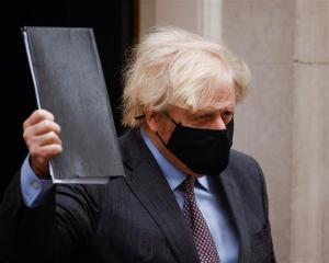Boris Johnson leaves Downing Street in London. Photo: Reuters