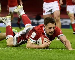 Wales' Kieran Hardy scores their third try. Photo: Reuters