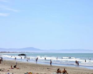 People enjoying the hot weather on Sumner Beach, Christchurch. Photo: George Heard / NZH