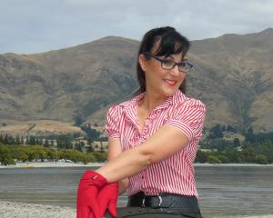Bozenka Raich, of Albert Town, strikes a pose on the lakefront in Wanaka.PHOTO: SIMON HENDERSON