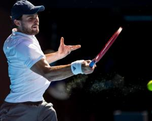 Aslan Karatsev of Russia returns the ball during the quarterfinal match with Grigor Dimitrov....