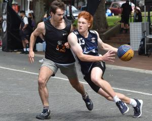 The Fellas guard Mitchell Hughan drives to the hoop as he is defended by Falcons guard Hamish...