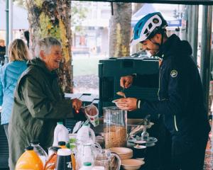 Liz Crook serving up breakfast with a smile at our 5th annual Bike Breakfast