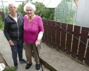 Balclutha neighbours Ila Ryan (left), and Val McNamara stand next to a garden border where Mrs...