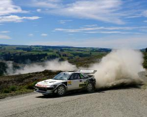 Mosgiel driver Chris Hey sprays some dust in the Burma Rd hill climb event in South Otago last...