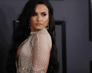 Demi Lovato has taken over as sole female Smurf, Smurfette in the upcoming film replacing Katy Perry. Photo: Reuters