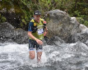 Dougal Allan tries to make his way through a waterway at last year's Coast to Coast event. PHOTO:...