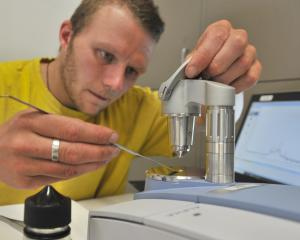 Know Your Stuff NZ Dunedin team leader Ashley Heydon legally tests a drug sample at the...