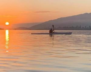 Twizel's Craig Lay enjoys the backdrop of a spectacular sunrise during a recent kayak training...