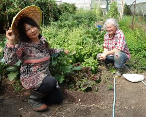 Raspberry Cottage owner Sarala Tamang (left) and its previous owner Margaret Little crouch beside...
