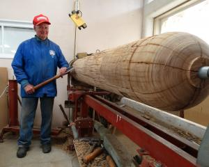 Waitaki Woodturners Guild treasurer Bill Owen gets ready to reshape an old power pole, which will...