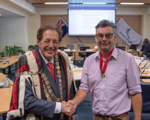 Invercargill Mayor Sir Tim Shadbolt welcomes Marcus Lush on to the council after he was sworn in...