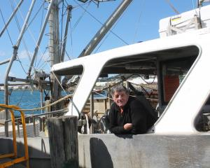 Oysterman John Edminstin prepares his fishing boat Polaris for the beginning of oyster season...