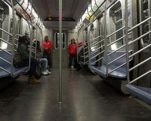 The Guardian Angels patrol the New York subway in Brooklyn & Manhattan for the first time in...