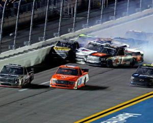 Ben Rhodes (99, left) races for the finish line as Drew Dollar, Kris Wright (02) and Grant...