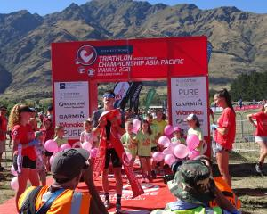 Challenge Wanaka half winner Kyle Smith enjoys the moment on Saturday morning. PHOTO: KERRIE...