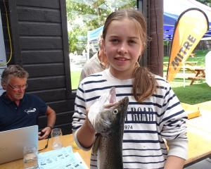 Sarah Dougherty (12), of Wanaka, holds the 716g brown trout that did not get away. PHOTO: KERRIE...