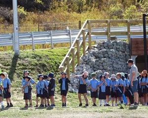 Te Kura O Take Karara school teacher Caitlin Crampton leads a group of year 3 and 4 pupils '...